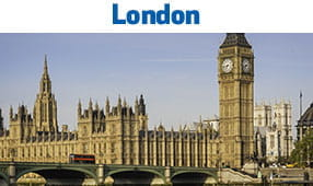 London, England - Big Ben clock with connecting bridge over water
